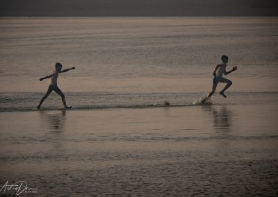 Kumbh Mela Boys Running in the Ganges