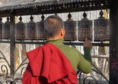 Monk Spinning Prayer Wheels