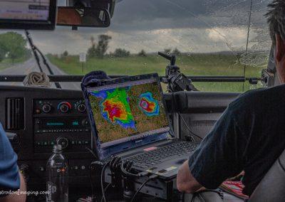 Lead Meteorologist Predicting Storm